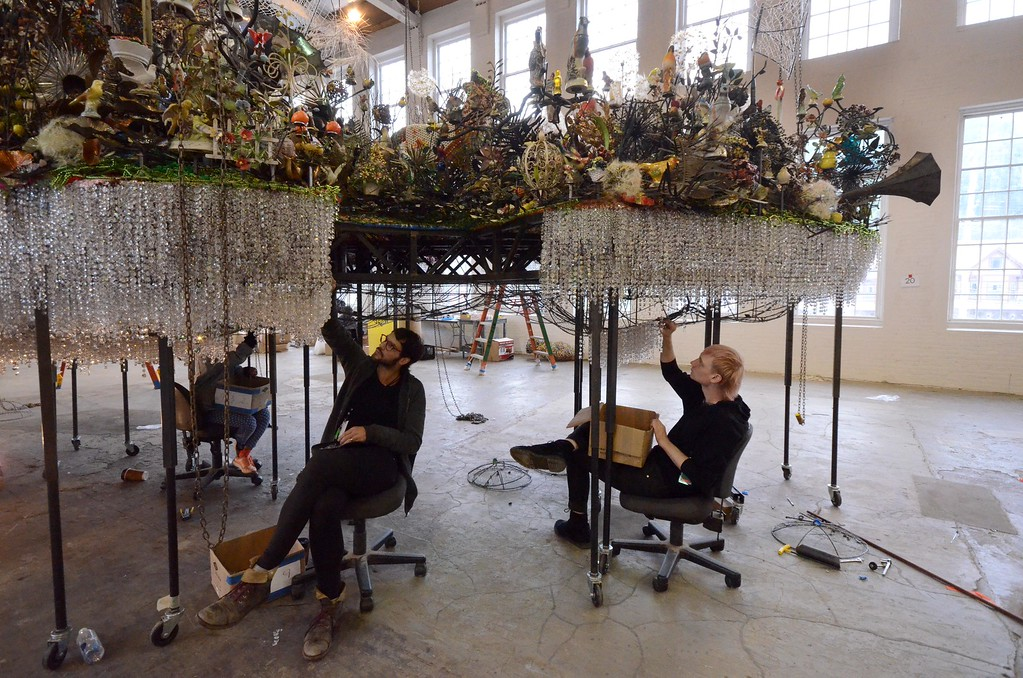 . Dave Birmingham and Jasper Drummond work on the bead installation of the bottom half of the cloud in Nick Cave\'s \'Until\' which will be on display in the football size gallery at Mass MoCA starting on October 15. Tuesday, October 4, 2016. Gillian Jones � The Berkshire Eagle | photos.berkshireeagle.com