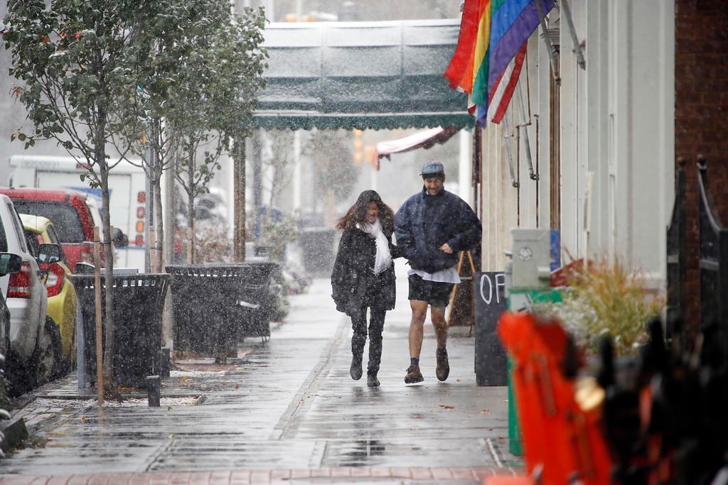 . Walkers in downtown Great Barrington are surrounded by the season\'s first real snow. Thursday, October 27, 2016. Stephanie Zollshan � The Berkshire Eagle | photos.berkshireeagle.com