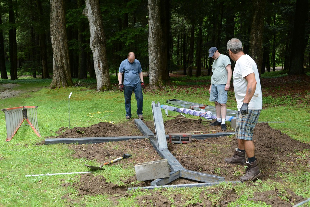 . Workers construct a steel sculpture by Chris Plaisted titled \'Harbinger\' which is on display on the grounds of The Mount, Edith Wharton\'s home, in Lenox, as part of \'Remix\' an outdoor sculpture exhibition, on Monday, May 30, 2016. Gillian Jones � The Berkshire Eagle | photos.berkshireeagle.com