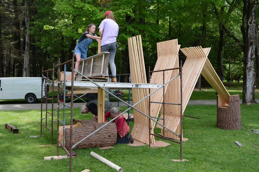 . Artists Rick and Laura Brown, below, construct their wood and steel sculpture titled \'Namassakeesett\' which is on display on the grounds of The Mount, Edith Wharton\'s home, in Lenox, as part of \'Remix\' an outdoor sculpture exhibition, on Monday, May 30, 2016. Gillian Jones � The Berkshire Eagle | photos.berkshireeagle.com