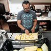 BEN GARVER — THE BERKSHIRE EAGLE<br /> Jose Taveras prepares squash from the Pittsfield Community Gardens to be vacuum sealed and frozen for Pittsfield food pantrys at the First United Methodist Church kitchen on Fenn Street, Monday July 22, 2019. The vegetables are from various gardens across the city (the squash this week is from the garden at the Common) and will be used well beyond the growing season. The community gardens are part of the Department of Community Development.  Volunteers brom Berkshire ARC are helping out today, but any volunteer is welcome Mondays at 1:30 pm during the growing season.