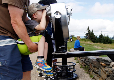 Servicing viewing binoculars atop Mt. Greylock-081716