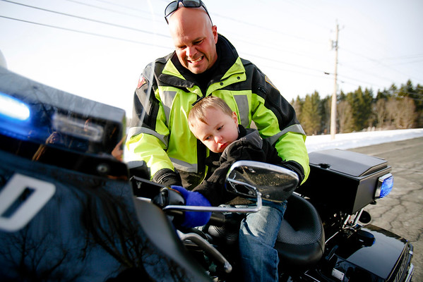 Tony Maschino, 3, gets a visit from police and a ride on a motorcycle-112316