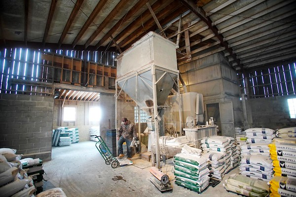 BEN GARVER — THE BERKSHIRE EAGLE<br /> Rob Pecor mixes and bags a ton of chicken feed at Wirtes Farm in Lanesborough, Monday, February 18, 2019. The one ton batch is made from corn, soy and molasses.  The farm mixes feed for a variety of livestock.