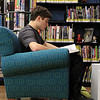 Andrew Parkinson, 15, a sophomore at Lunenburg Middle High School does his homework for his history class in the Teen Room at the Lunenburg Public Library on Wednesday afternoon. He was studying the American Revolution. SENTINEL & ENTERPRISE/JOHN LOVE