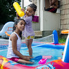 Jasmarie Calderon, 3, cools off with sister Jasaida Trinidad, 7, in a kiddie pool on Thursday afternoon as temperatures reached into the high 90s. SENTINEL & ENTERPRISE / Ashley Green