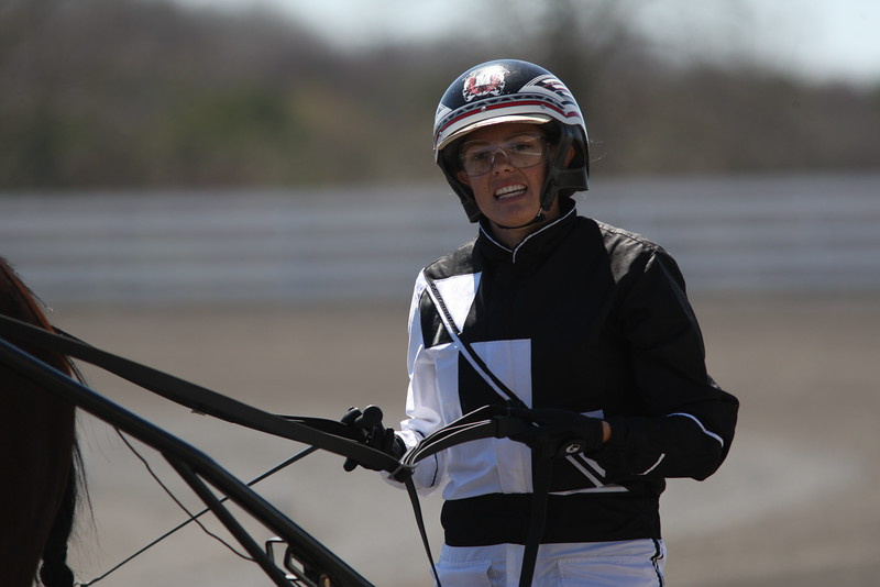 Hannah Miller in the Winner's Circle after placing first  with Shanghi Jack in the  Fourth Race.