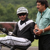 Robert Henchkoff driving Danger Sign N won the fourth race, and is pictured with John Manzi, Monticello Public Relations.