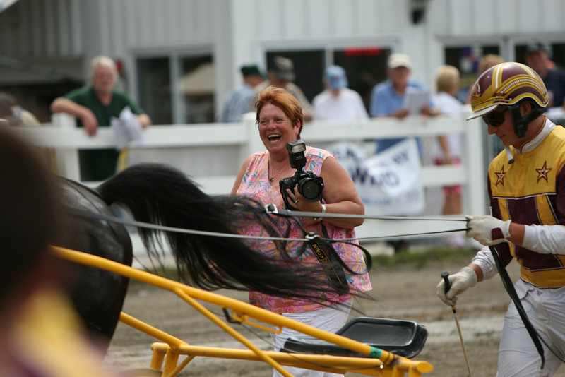 Track Photographer Shelley Gilpatrick enjoys some of the comments in the Winner's Circle after a win by Mitchell Cushing and Neverdie in the Third Race. The Cushing  Family turned out for a gathering in celebration of Mitchell's first win.