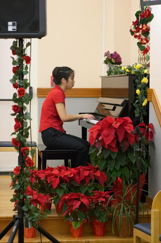 2005 12 10 Sat - Jenny Alyono framed by poinsettias & rose decor