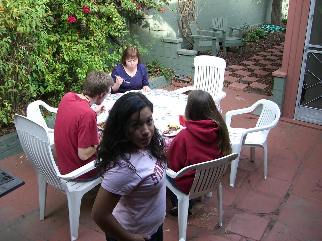 2005 12 18 Sun - Lake Ave Church - Rob Majors, Mrs  Sloat, & Jenna Sloat grub while Jennifer Evans pouts