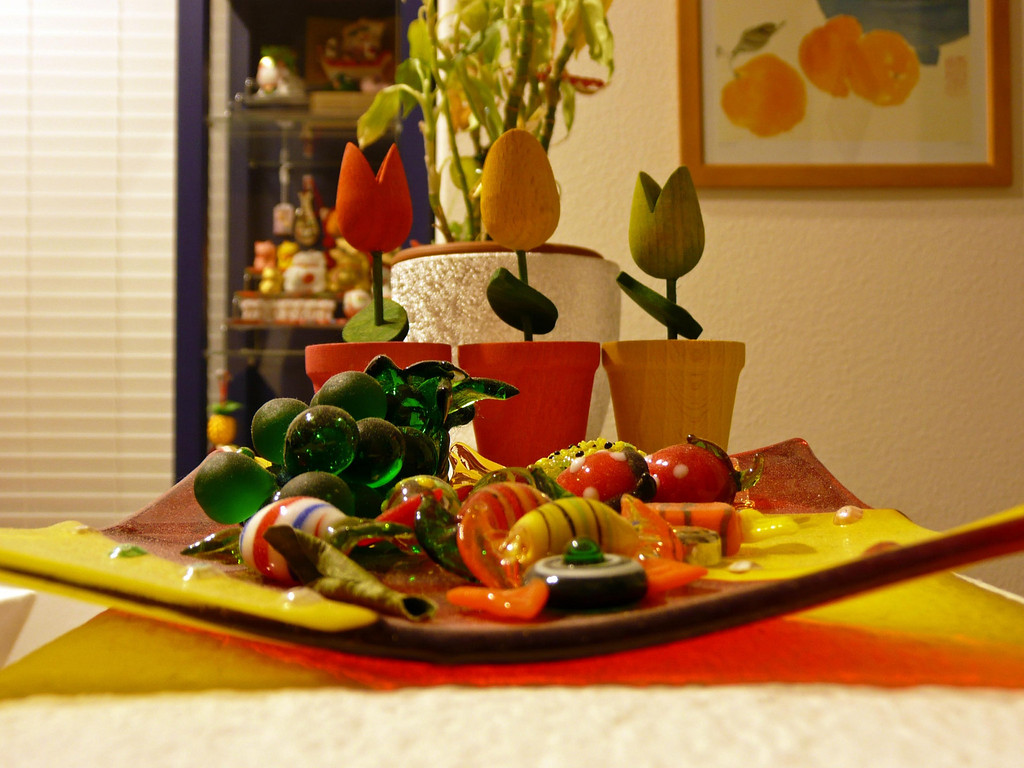 Taken with my Panasonic TZ3.  You can clearly see the dusts on the glass candies and plate :)