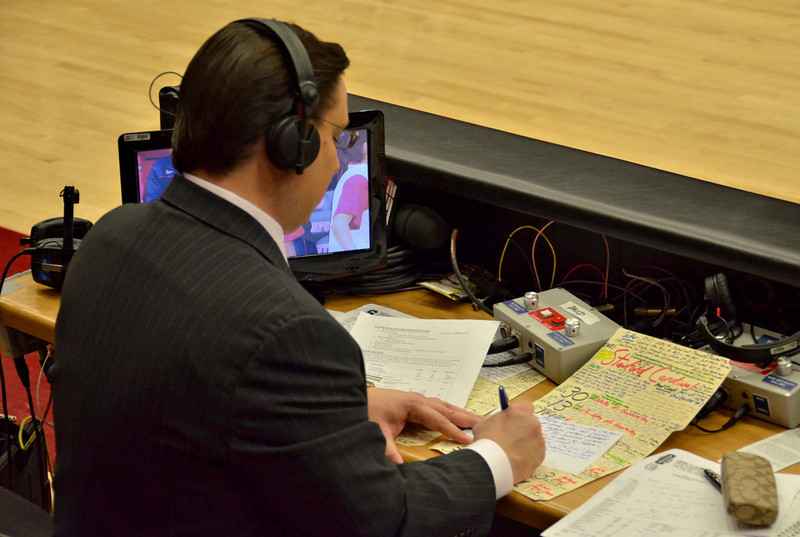The ESPN announcer works on his game notes.