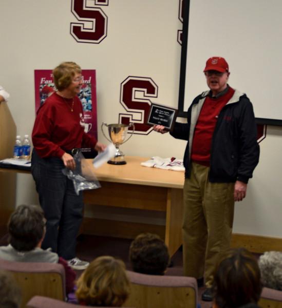 Harriet Benson awards the Fan Spirit award to Wally Mersereau