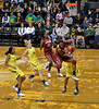 Getting an O-board -- in one of those common coincidences, the A.P. photographer snapped this identical moment, but shooting from low on the baseline. Exact same pose, Nneka in the air curled around the ball.