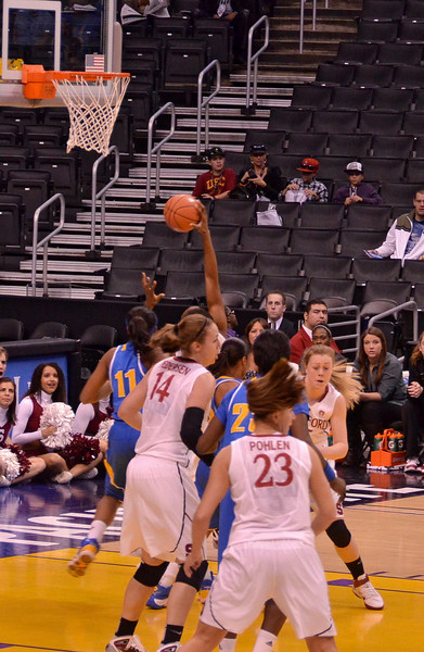 Chiney reaches up for a rebound
