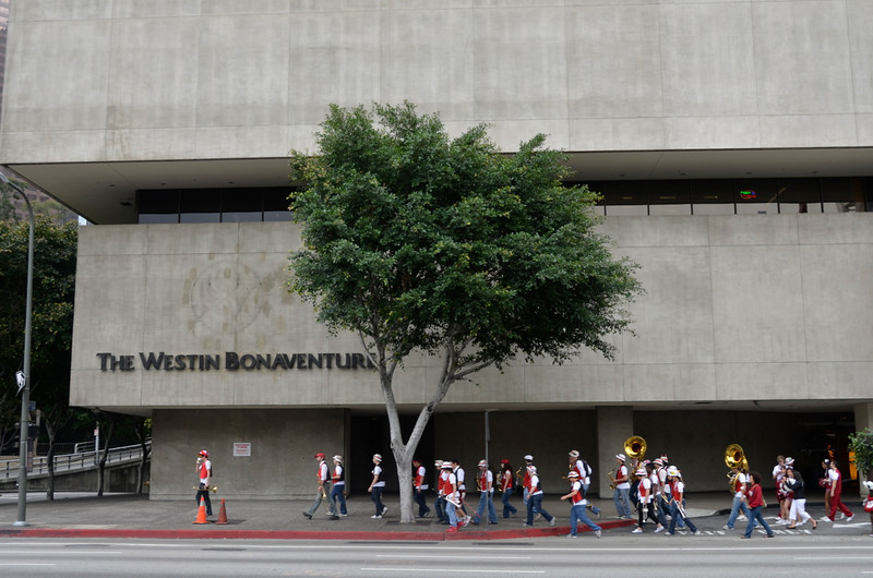 The band troops along Figueroa toward the team hotel for the send-off.