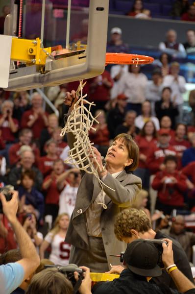 Tara cuts down the net.