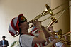 Trombonist with goggles and hat.