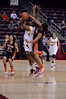 In the first game of the tournament, El Sara Greer of OSU puts a block on Janae Fulcher of ASU