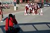 Cheerleaders pose for photographer