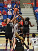 Nneka and Kayla going for a defensive rebound