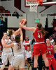 Sara, Jos, and Seattle's Kacie Sowell go for a rebound