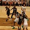 Toni grabs a rebound.