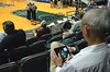 Detached fan plays texas hold-em on his ipad during timeout