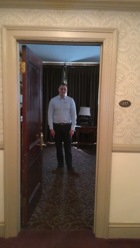 Stanley Hotel Archivist stands in the exact location in Room 217 where the explosion took place.