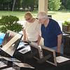Mary Lou Gerrish and Joyce Piper look over some of the items up for the silent auction.