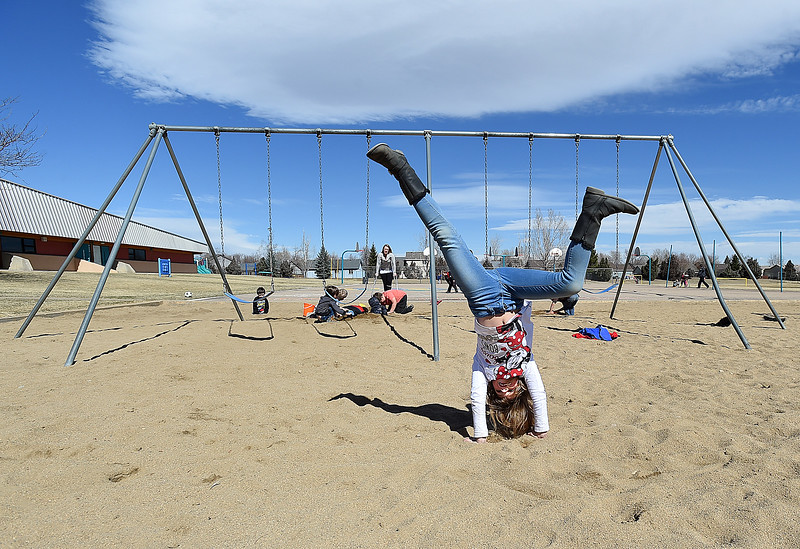 Alora Majchrowicz, 6, a Stansberry Elementary School kindergartener, does cartwheels during recess Wednesday, March 8, 2017, at the school in north Loveland. The Thompson School District Board of Education is considering closing Stansberry Elementary School and Van Buren Elementary School. (Photo by Jenny Sparks/Loveland Reporter-Herald)