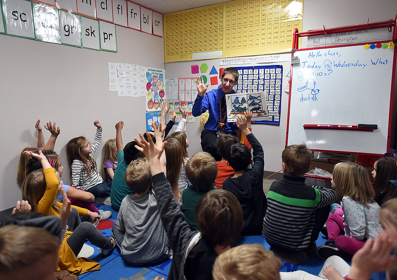Kindergarten teacher Erik Hagan reads a book to his class at Stansberry Elementary School Wednesday, March 8, 2017, in north Loveland. The Thompson School District Board of Education is considering closing Stansberry Elementary School and Van Buren Elementary School. (Photo by Jenny Sparks/Loveland Reporter-Herald)