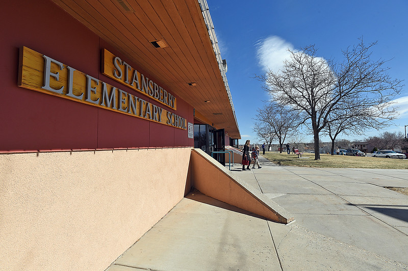 Children and parents leave Stansberry Elementary School for the day Wednesday, March 8, 2017, in north Loveland. The Thompson School District Board of Education is considering closing Stansberry Elementary School and Van Buren Elementary School. (Photo by Jenny Sparks/Loveland Reporter-Herald)