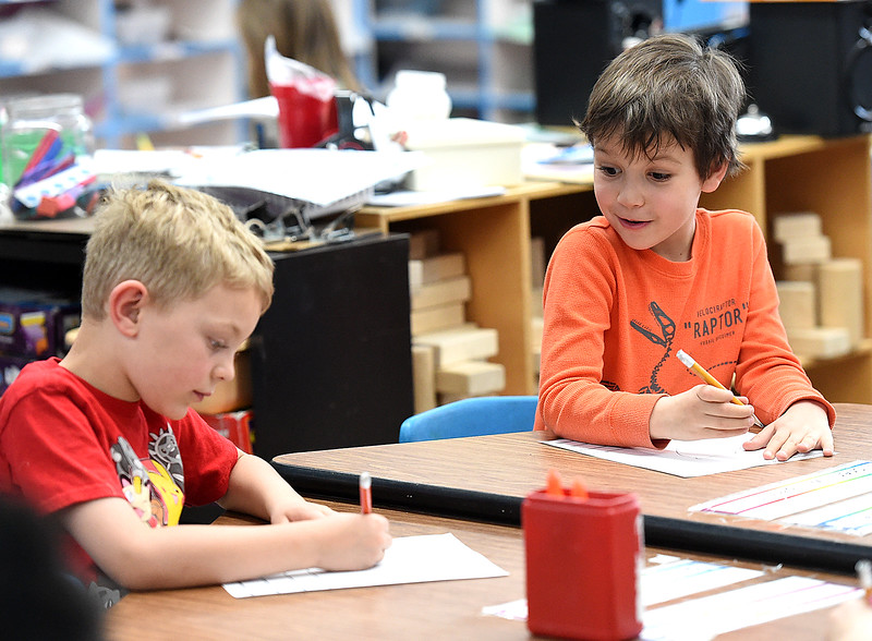 Stansberry Elementary School kindergartener Fisher Williams, 6, right, looks to see which animal his classmate, Bobby Spratt,5, is drawing during class Wednesday, March 8, 2017, at the school in north Loveland. The Thompson School District Board of Education is considering closing Stansberry Elementary School and Van Buren Elementary School. (Photo by Jenny Sparks/Loveland Reporter-Herald)