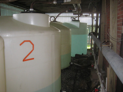 Drinking water. produced by a desalinization process, is chlorinated and stored in these tanks (allowing time for some of chlorinated taste to disappear).  Additional water brought by boat from the mainland is added.