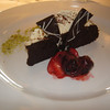 Flourless chocolate cake with double cream and mixed berries