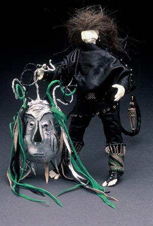 Star Wanderer holding mask