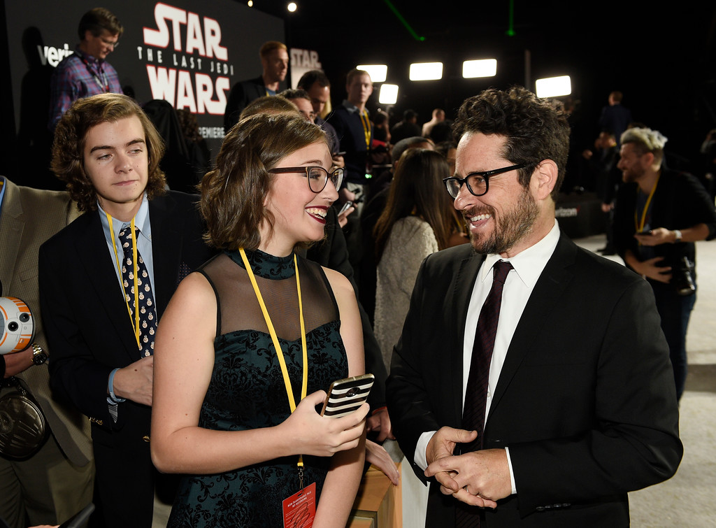 """. In this Dec. 9, 2017 photo, \""""Star Wars: The Last Jedi\"""" executive producer J.J. Abrams, right, mingles with Shannon McNabb, 18, of Charlestown, W. Va., at the premiere of the film in Los Angeles. McNabb was one of seven teens with life-threatening medical conditions who were among the special guests at the premiere as part of the Make-A-Wish Foundation.(Photo by Chris Pizzello/Invision/AP)"""
