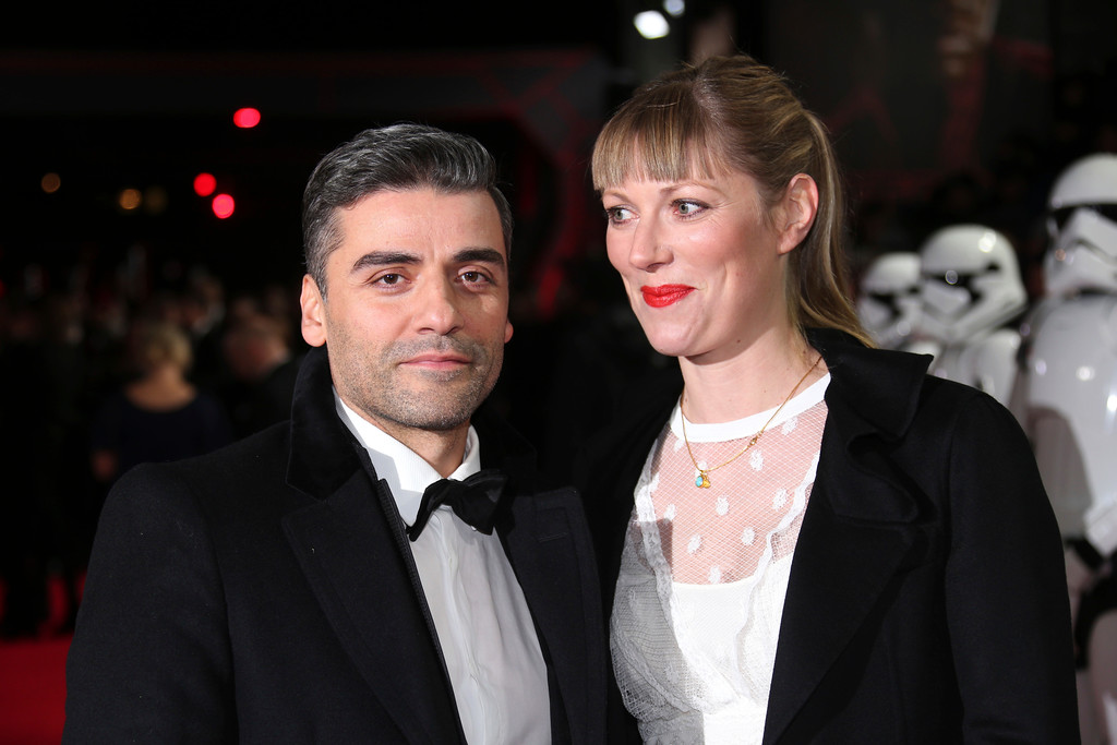 . Actor Oscar Isaac, left, and Elvira Lind pose for photographers upon arrival at the premiere of the film \'Star Wars: The Last Jedi\' in London, Tuesday, Dec. 12th, 2017. (Photo by Joel C Ryan/Invision/AP)