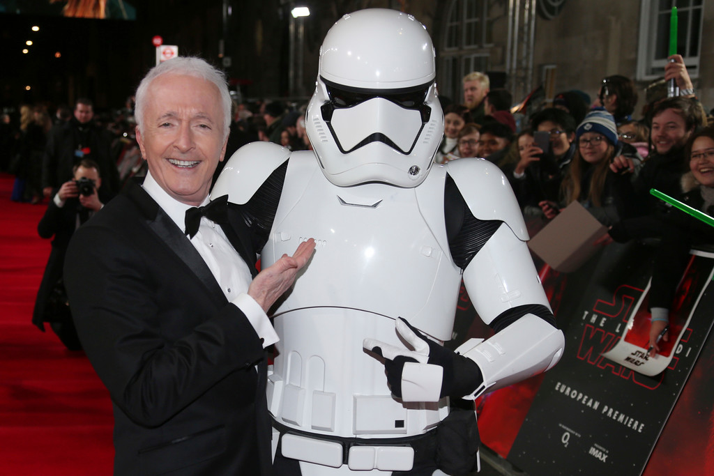 . Actor Anthony Daniels poses with a person dressed as a stormtrooper for photographers upon arrival at the premiere of the film \'Star Wars: The Last Jedi\' in London, Tuesday, Dec. 12th, 2017. (Photo by Joel C Ryan/Invision/AP)