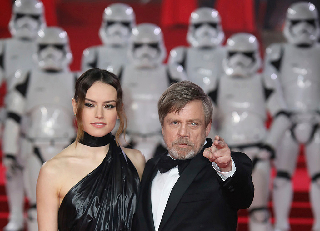 . Actors Daisy Ridley, left, and Mark Hamill pose for photographers upon arrival at the premiere of the film \'Star Wars: The Last Jedi\' in London, Tuesday, Dec. 12th, 2017. (Photo by Vianney Le Caer/Invision/AP)