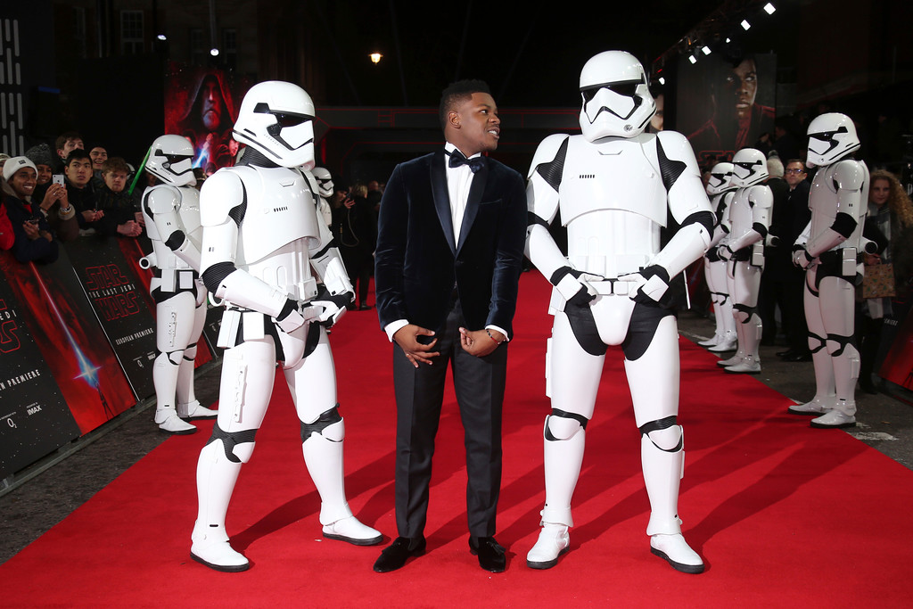 . Actor John Boyega poses for photographers with people dressed as stormtroopers upon arrival at the premiere of the film \'Star Wars: The Last Jedi\' in London, Tuesday, Dec. 12th, 2017. (Photo by Joel C Ryan/Invision/AP)