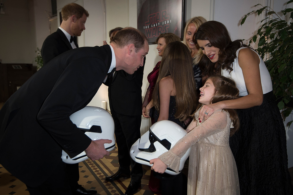 . Britain\'s Prince William speaks with Eloisa Lerner, 8, at the European premiere of \'Star Wars: The Last Jedi\' at the Royal Albert Hall, in central London, Tuesday, Dec. 12, 2017. The premiere is hosted in aid of The Royal Foundation of the Duke and Duchess of Cambridge and Prince Harry. (Eddie Mulholland/Pool Photo via AP)