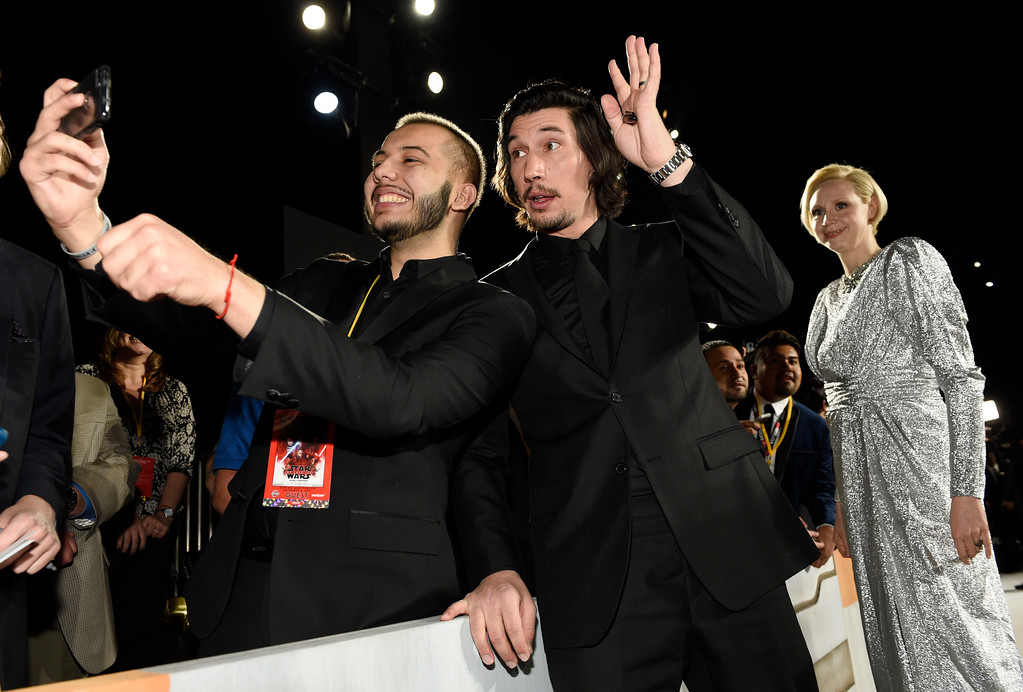 """. In this Dec. 9, 2017 photo, \""""Star Wars: The Last Jedi\"""" cast member Adam Driver, center, poses for a photo with Chris Alegria, left, as fellow cast member Gwendoline Christie looks on at the premiere of the film \""""Star Wars: The Last Jedi\"""" at the Shrine Auditorium in Los Angeles. Alegria was one of seven teens with life-threatening medical conditions who were among the special guests at the premiere as part of the Make-A-Wish Foundation. (Photo by Chris Pizzello/Invision/AP)"""