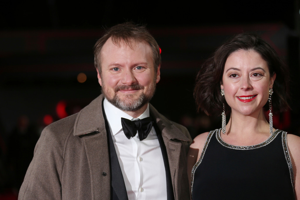 . Director Rian Johnson, left, and Karina Longworth pose for photographers upon arrival at the premiere of the film \'Star Wars: The Last Jedi\' in London, Tuesday, Dec. 12th, 2017. (Photo by Joel C Ryan/Invision/AP)