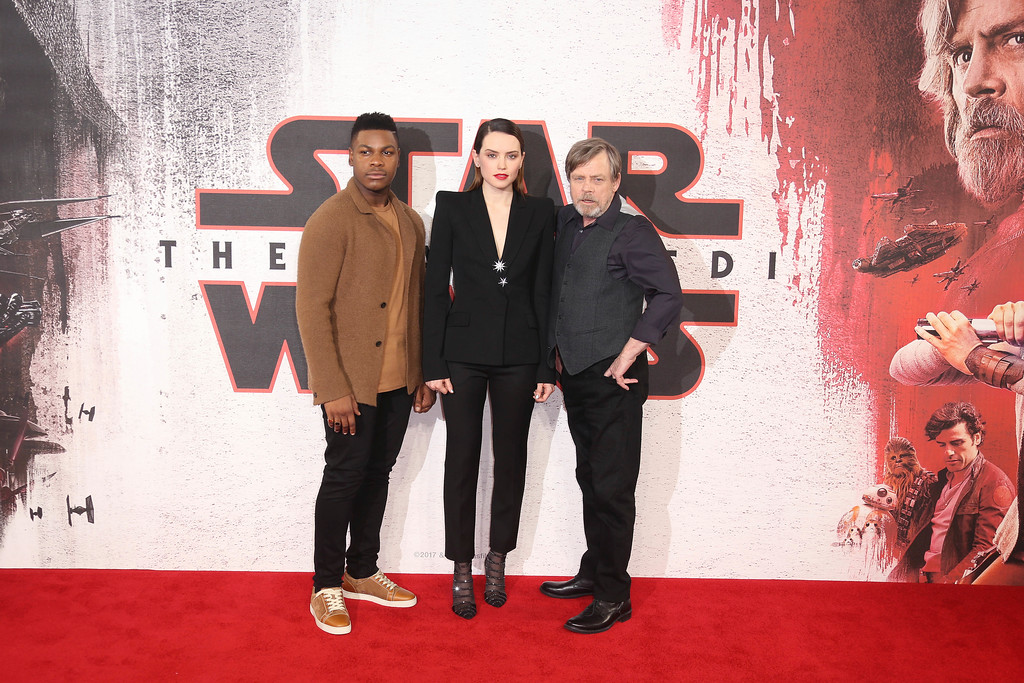 . Actors Mark Hamill, from left, Daisy Ridley and John Boyega pose for photographers at the photo call for the film \'Star Wars: The Last Jedi\' in London, Wednesday, Dec. 13th, 2017. (Photo by Joel C Ryan/Invision/AP)