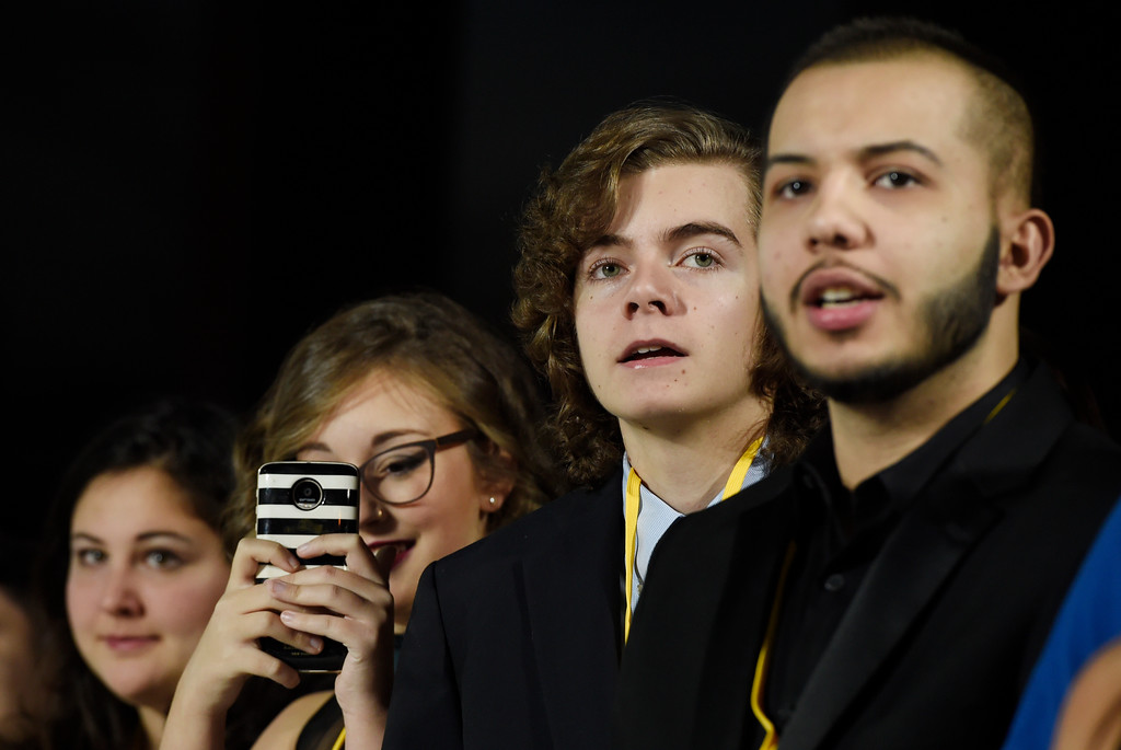 """. In this Dec. 9, 2017 photo, Oliva Sava, from left, Shannon McNabb, Tyler Woodward and Chris Alegria peer down the red carpet from their spot at the premiere of the film \""""Star Wars: The Last Jedi\"""" in Los Angeles.  The teens were among seven teens with life-threatening medical conditions who were among the special guests at the premiere as part of the Make-A-Wish Foundation. (Photo by Chris Pizzello/Invision/AP)"""
