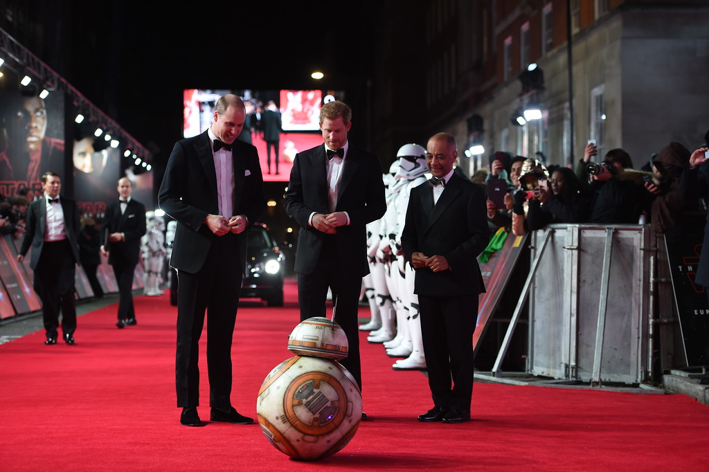. Prince William, Duke of Cambridge, left, and Prince Harry meet a BB8 Droid Sphero on the red carpet as they attend the European premiere of Star Wars: The Last Jedi, at the Royal Albert Hall, in central London, Tuesday, Dec. 12, 2017. The premiere is hosted in aid of The Royal Foundation of the Duke and Duchess of Cambridge and Prince Harry. (Eddie Mulholland/Pool Photo via AP)