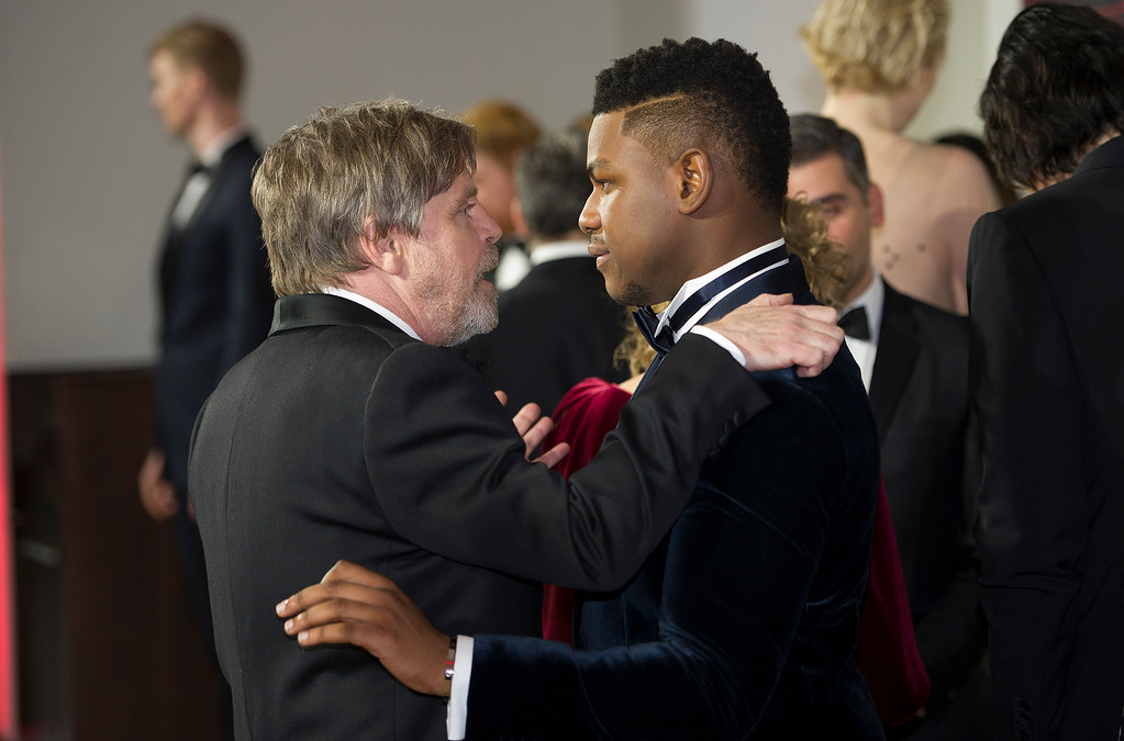 . Actors Mark Hamill, left, and John Boyega speak at the European premiere of \'Star Wars: The Last Jedi\' at the Royal Albert Hall, in central London, Tuesday, Dec. 12, 2017. The premiere is hosted in aid of The Royal Foundation of the Duke and Duchess of Cambridge and Prince Harry. (Eddie Mulholland/Pool Photo via AP)